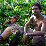 Koji Ah-Choo, foreground, a member of the Bardi Aboriginal clan of the northwestern Kimberly region of Australia,  rests with Sam Bright, of southwestern Australia, near a leafy spring on Sunday Island. Sunday island one of a chain of islands that make up part of the Bardi's traditional ancestral lands. Photo by Jen Klewitz