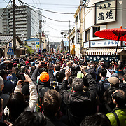 KAWASAKI, JAPAN - APRIL 2 : Festival goers waits for a large phallus shaped portable shrine during the annual Kanamara Festival in Kawasaki, Japan on April 2, 2017. The fertility festival, originated from prostitutes who wished to pray for good business and protection from sexually transmitted diseases, nowadays, celebrates for fertility, relationships and safe sex practices, including AIDS prevention. Attracted with Tens of thousands festival goers including tourist, people can buy penis shape candies, key chains, trinkets, pens, chocolates and even toy glasses with a plastic penis nose. (Photo by Richard Atrero de Guzman/NUR Photo)