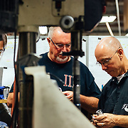 (R to L) Scott Beam, Dave Morgan, and Tracy Vaughn try to solve a specific manufacturing problem related to the rear shocks coming off of the line in the machine shop.