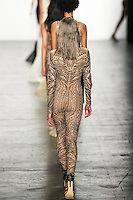 Marga Esquivel (Women) walks the runway wearing Tadashi Shoji Fall 2016 during New York Fashion Week on February 12, 2016