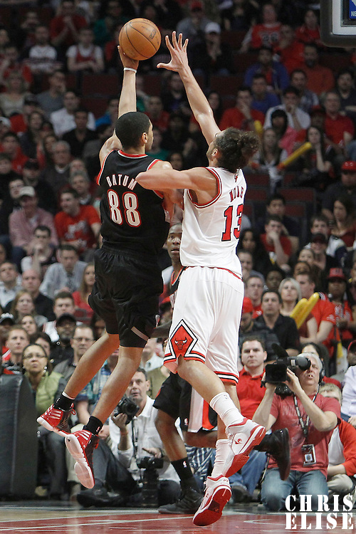 16 March 2012: Portland Trail Blazers small forward Nicolas Batum (88) goes for the layup against Chicago Bulls center Joakim Noah (13) during the Portland Trail Blazers 100-89 victory over the Chicago Bulls at the United Center, Chicago, Illinois, USA.