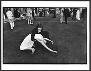 Alexander Fyjis-Walker  here is dancing with Sarah Fazakerly during the Trinity Ball. Cambridge.  In June 1981  wasn't employed by anyone as a photographer but spent a week photographing May Balls in Cambridge. Staying with another photographer friend Nicholas Lee we's sleep through most of the day and at night take pictures. On this evening  I photographed  gatecrashers climbing in and then as dawn approached and the security relaxed it was possible to walk into the  colleges As this was early in the morning  there wasn't much light. My camera was on a slow shutter speed. They kind of froze for a moment in this amazing position.<br /> . 15 June 1981. Film 8133f25