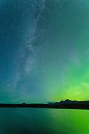 Milky Way and Aurora Borealis above the Alaska Range mountains at Round Tangle Lake along the Denali Highway in Interior Alaska. Autumn. Morning.