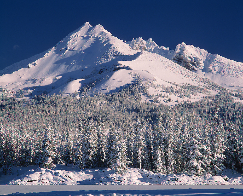 A thick layer of snow covers Broken Top in the Cascades Range of Central Oregon.
