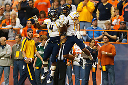Oct 21, 2011; Syracuse NY, USA;  West Virginia Mountaineers wide receiver Brad Starks (2) celebrates with wide receiver Devon Brown (4) after scoring a touchdown against the West Virginia Mountaineers during the fourth quarter at the Carrier Dome.  Syracuse defeated West Virginia 49-23. Mandatory Credit: Jason O. Watson-US PRESSWIRE