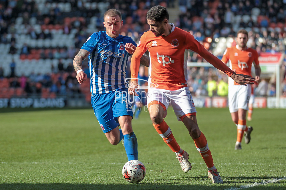 Lewis Alessandra (Hartlepool United) and Kelvin Mellor (Blackpool) run to get to the ball during the EFL Sky Bet League 2 match between Blackpool and Hartlepool United at Bloomfield Road, Blackpool, England on 25 March 2017. Photo by Mark P Doherty.
