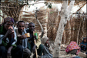 "Guests of two young girls' early marriage celebration, drink tella at the compound dedicated to the wedding. Various UN commisioned reports indicated a high incidence of marriage among girls before the age of 15 in many Sub-Saharan countries. North West of Ethiopia, on friday, Febrary 13 2009.....In a tangled mingling of tradition and culture, in the normal place of living, in a laid-back attitude. The background of Ethiopia's ""child brides"", a country which has the distinction of having highest percentage in the practice of early marriages despite having a law that establishes 18 years as minimum age to get married. Celebrations that last days, their minds clouded by girls cups of tella and the unknown for the future. White bridal veil frame their faces expressive of small defenseless creatures, who at the age ranging from three to twelve years shall be given to young brides men adults already...To protect the identities of the recorded subjects names and specific places are fictional."