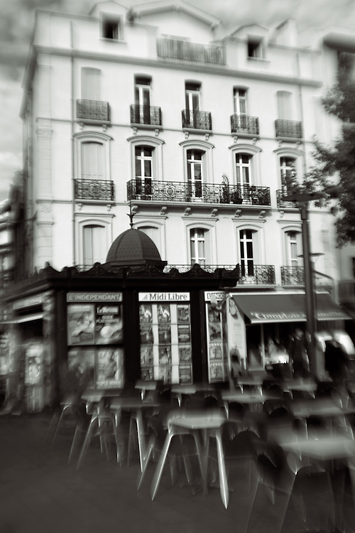 french outdoor cafe with newstand and building,black and white verticle
