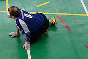 Goalball Spieler des tschechischen Teams Ivos Budil erwartet den Anwurf der gegnerischen Mannschaft w&auml;hrend dem internationalen Turnier in Budapest. Goalball ist eine Mannschaftssportart f&uuml;r blinde und sehbehinderte Menschen und wurde vom &Ouml;sterreicher Hans Lorenzen und dem deutschen Sepp Reindle f&uuml;r Kriegsinvalide entwickelt und zum ersten Mal 1946 gespielt. Die Bilder entstanden auf zwei internationalen Goalball Turnieren in Budapest und Zagreb 2007.<br /> <br /> Goalball player Ivos Budil from the Czech team expecting the ball from the oppenent team during an international tournament in Budapest. Goalball is a team sport designed for blind and visually impaired athletes. It was devised by an Austrian, Hanz Lorenzen, and a German, Sepp Reindle, in 1946 in an effort to help in the rehabilitation of visually impaired World War II veterans. The International Blind Sports Federatgion (IBSA - www.ibsa.es), responsible for fifteen sports for the blind and partially sighted in total, is the governing body for this sport. The images were made during two Goalball tournaments in gBudapest and Zahreb 2007.