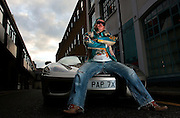 UK ENGLAND LONDON 15NOV06 - Darryn Lyons, also known as 'Mr Paparazzi' and chairman of the celebrity photo agency Big Pictures poses for a portrait with his Ferrari 360 Spider in Kensington, West London.<br />