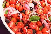 Freshly cut cherry Tomato salad with onions and basil