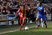 Dominic Poleon of Bradford City goes past Gillingham defender Gabriel Zakuani during the EFL Sky Bet League 1 match between Bradford City and Gillingham at the Northern Commercials Stadium, Bradford, England on 24 March 2018. Picture by Paul Thompson.