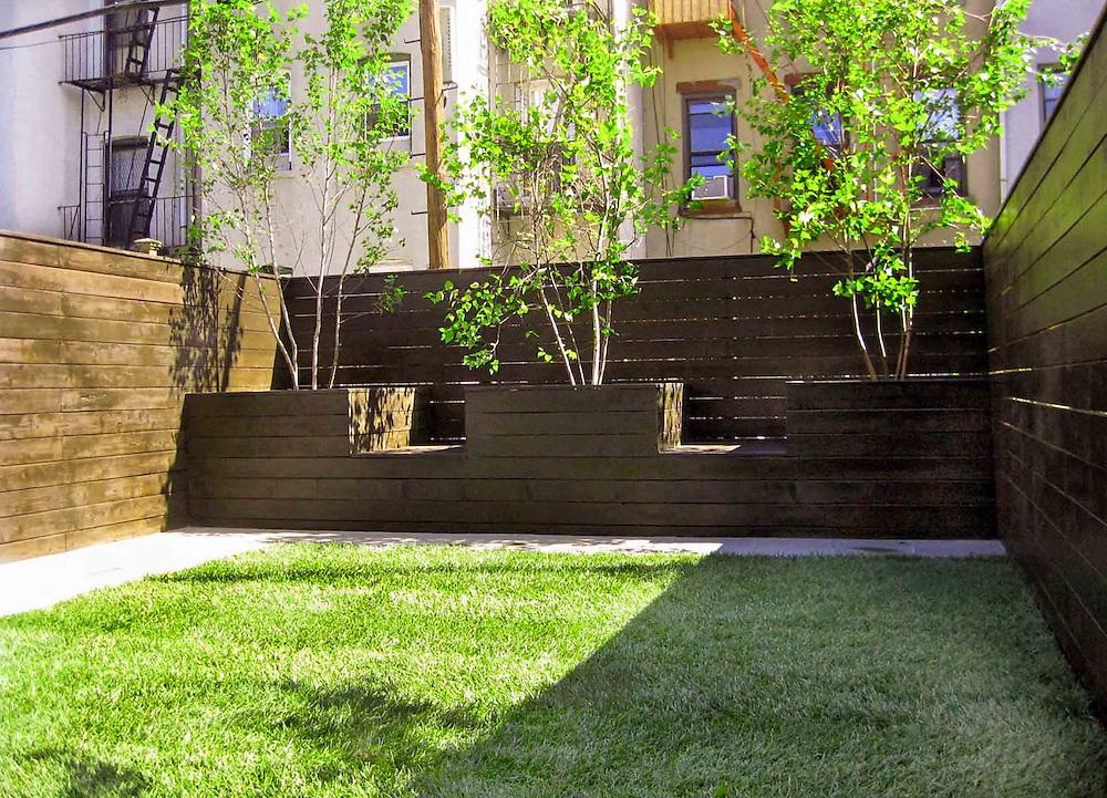 Modern Minimal Garden Featuring Horizontal Fencing Lawn
