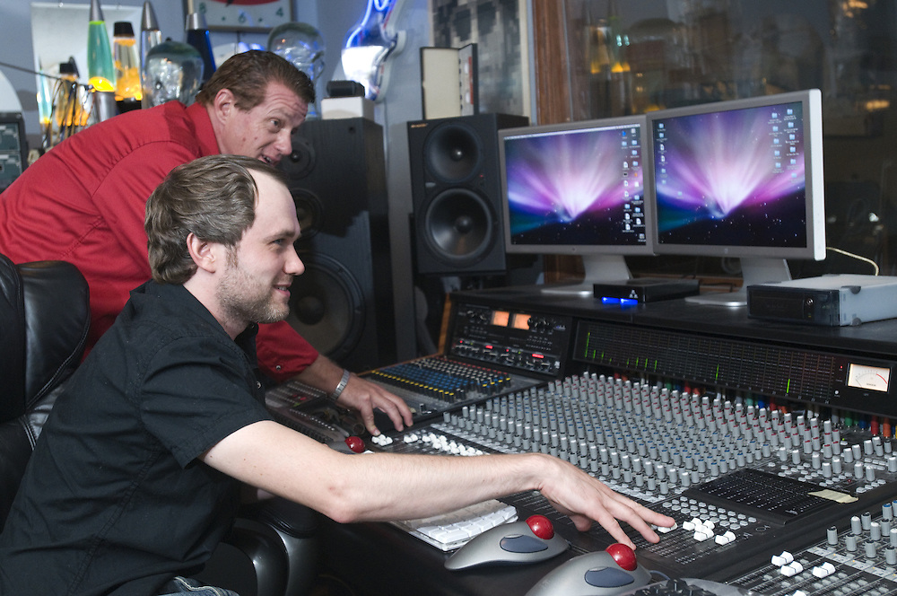 "Tyler Morrison, seated, and Wise ""Doc"" Smith at an older 96-channel analog mixing table in the control room, Thursday, July 26, 2012, at Liquid Sound Studios in Greenville, Ind. (Photo by Brian Bohannon)"