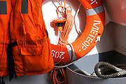 Life jacket and life buoy on board a boat