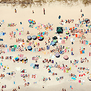Crowds of beach-goers pack the sands of Wrightsville Beach, NC, during the Fourth of July holiday weekend.