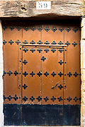 Traditional doorway with metal studs in Basque town of Laguardia in Rioja-Alavesa area of Spain