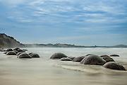 23 boulders stretched at along the coast at Moeraki Beach, New Zealand