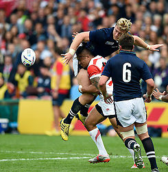 David Denton of Scotland offloads the ball after being tackled by Male Sa'u of Japan - Mandatory byline: Patrick Khachfe/JMP - 07966 386802 - 23/09/2015 - RUGBY UNION - Kingsholm Stadium - Gloucester, England - Scotland v Japan - Rugby World Cup 2015 Pool B.