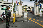 21 AUGUST 2014 - BANGKOK, THAILAND:      A Thai soldier guards the parliament building in Bangkok before the National Legislative Assembly (NLA) meeting to select a new Prime Minister. The NLA met Thursday to select the new Prime Minster. The NLA was hand picked by the Thai junta, formally called the National Council for Peace and Order (NCPO), and is supposed to guide Thailand back to civilian rule after a military coup overthrew the elected government in May. The NLA unanimously selected General Prayuth Chan-ocha, commander of the Thai Armed Forces and leader of the coup in May that deposed the elected civilian government, as Prime Minister. Prayuth is Thailand's 29th Prime Minister since the 1932 coup that created Thailand's constitutional monarchy. PHOTO BY JACK KURTZ