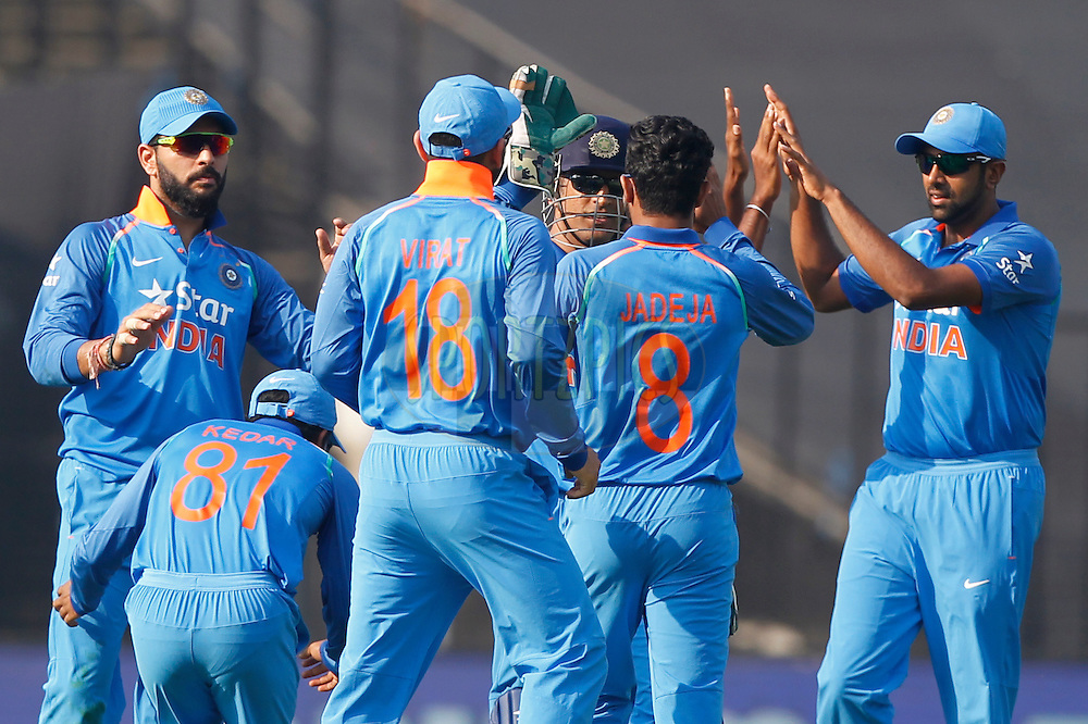 Team India celebrates the wicket of Sam Billings of England during the third One Day International (ODI) between India and England  held at Eden Gardens in Kolkata on the 22nd January 2017<br /> <br /> Photo by: Deepak Malik/ BCCI/ SPORTZPICS