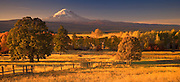 Looking at Mt, Adams across the Gifford Pinchot National Forest and ranches near Glenwood in the Cascade Mountain Range, WA, USA. autumn evening light panorama