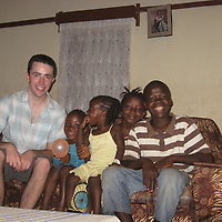 Ben Kirley Volunteer Work in Sierra Leone.....30.07.12<br /> Ben Kirley in the family home with Mamokor, Kadija, Bintu and Mada<br /> Picture by Graeme Hart.<br /> Copyright Perthshire Picture Agency<br /> Tel: 01738 623350  Mobile: 07990 594431