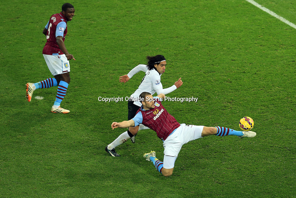 20 December 2014 - Barclays Premier League - Aston Villa v Manchester United - Ron Vlaar of Aston Villa tangles with Radamel Falcao of Manchester United as Jores Okore looks on - Photo: Marc Atkins / Offside.