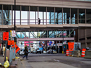 03 MAY 2017 - MINNEAPOLIS, MN: Skyways over 7th Street in downtown Minneapolis. The skyways are enclosed pedestrian overpasses that connect downtown buildings. The Minneapolis Skyway was started in the early 1960s as a response to covered shopping malls in the suburbs that were drawing shoppers out of the downtown area. The system grew sporadically until 1974, when the construction of the IDS Center and its center atrium, called the Crystal Court, served as a hub for the downtown skyway system. There are 8 miles of skyways, connecting most of the downtown buildings from Target Field (home of the Minnesota Twins) to US Bank Stadium (home of the Minnesota Vikings). In the last five years many upscale downtown apartment buildings and condominium developments have been added to the system, allowing downtown residents to live and work downtown without going outside.    PHOTO BY JACK KURTZ