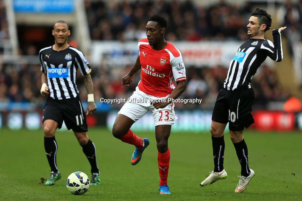 21 March 2015 - Barclays Premier League - Newcastle United v Arsenal - Danny Welbeck of Arsenal in action with Yoan Gouffran (L) and Remy Cabella of Newcastle United - Photo: Marc Atkins / Offside.