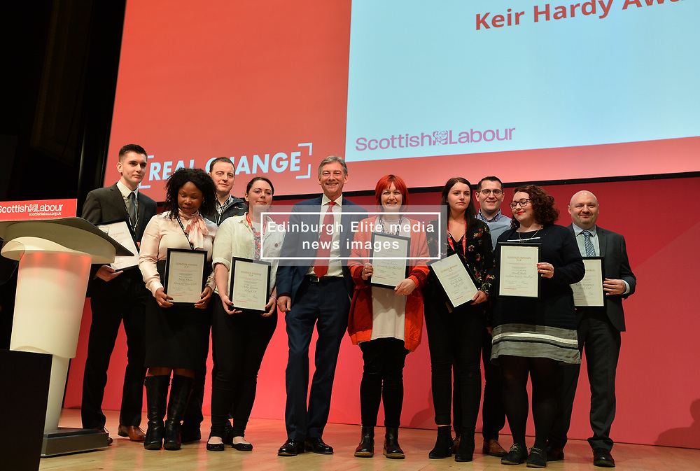 Scottish Labour leader Richard Leonard and the winners of the Keir Hardie award stand unaware of the spelling mistake on the giant screen behind them. The founder of the Labour Party originally had his name spelt out as Hardy instead of Hardie. The error was spotted and changed during the presentation.<br /> <br /> © Dave Johnston / EEm