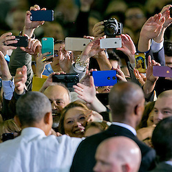 Attendees use their phones to take pictures of President Barack Obama after a speech inside the Caven-Williams Sports Complex on the campus of Boise State University. Wednesday January 21, 2015
