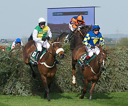 LIVERPOOL, ENGLAND, Saturday, April 9, 2011: Jason Maguire riding Ballabriggs jumps the Chair fence in second place from Santa's Son (Jamie Moore) before going on to win the Grand National during Day Three of the Aintree Grand National Festival at Aintree Racecourse. (Photo by David Rawcliffe/Propaganda)