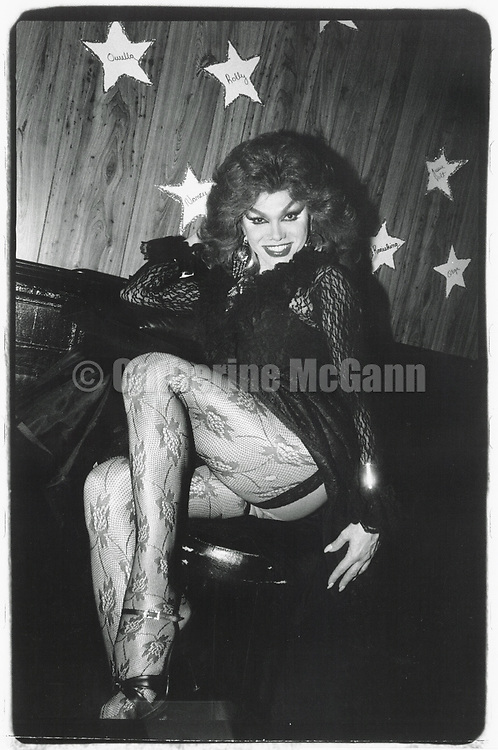 1990s:  A drag queen poses for a portrait at Sally's Hideaway drag bar in Times Square in New York City.