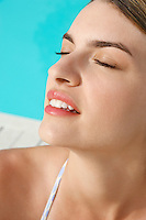 Woman Relaxing by pool close up of head