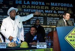 "March 2, 2006 - New York, NY - WBC Junior Middleweight Champion Ricardo ""El Matador"" Mayorga (l) listens on as challenger ""The Golden Boy"" Oscar DeLaHoya (l) speaks at the NY press conference announcing their May 6th title fight.  The fight will take place in Las Vegas."