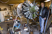 ICE.MWdrv04.02.xrw..Björn Thoroddsen, a former pilot for Iceland Air, is spending his retirement building a plane in the workshop of his house in the harbor town of Hafnarfjördur, Iceland, outside Reykjavik. Ten years ago he and his family were the Icelandic participants in Material World: A Global Family Portrait, 1994 for which they took all of their possessions out of their house for a family and possessions portrait in the snow. Pages 162-163. {{See also ICE.MWdrv04.01.xrw}} {{Central image from original book project is: ICE.mw.01.xxs.}}.
