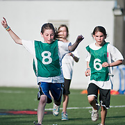 June 2, 2010 - Bronx, NY : SAR hosted a charity soccer tournament at its lower school on June 2.  Sixth graders Dahlia Finther, left, and .Arielle Goldman of the New Zealand team face off against Spain.