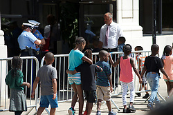 Group of young children enters a charter school on the 800 block of North Broad Street, in North Philadelphia, PA. At the location Republican candidate Donald Trump is scheduled to meet with Republican, African-American leaders at a September 2, 2016 roundtable discussion in North Philadelphia, Pennsylvania