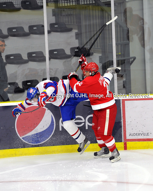 Spencer Hyman #2 of the Hamilton Red Wings makes the hit on a Toronto Junior Canadiens player during first period game actionCOBOURG,ON-Oct14:.Ontario Junior Hockey League Game Action.between,.(Photo By Andy Corneau / OJHL Images)
