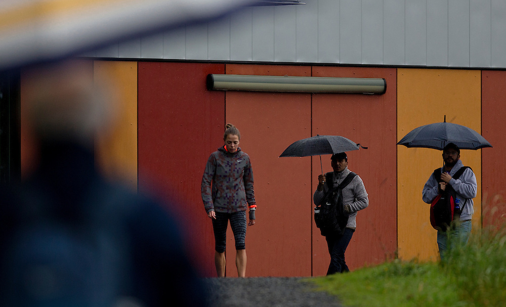 Melissa Bishop runs hill sets in the rain under the watchful eye of her personal coach Dennis Fairall at the Pacific Institute for Sport Excellence on December 3rd, 2015 in Victoria, British Columbia Canada.