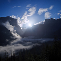 Yosemite by moonlight is a magical experience. We just arrived at Yosemite at Tunnel View to discover some low laying fog in the valley below. We waited for the moon to rise illuminating the granite cliffs and waterfalls of Yosemite by Moonlight.