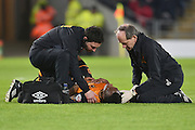 Hull City midfielder Moses Odubajo (2) receives attention for an injury during the Sky Bet Championship match between Hull City and Brighton and Hove Albion at the KC Stadium, Kingston upon Hull, England on 16 February 2016. Photo by Ian Lyall.