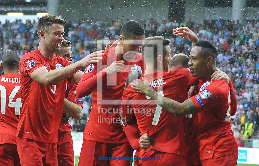 Wayne Rooney of England celebrates scoring their third goal with team mates during the UEFA Euro 2016 Qualifying match at Stozice Stadium, Ljubljana<br /> Picture by Stefano Gnech/Focus Images Ltd +39 333 1641678<br /> 14/06/2015