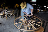 Warren Sveum taking part in a Wheelwright demonstration in the Gastrow's Carpenter Shop, Cooperage & Wheelwright Shop. The business is part of a 30 buidling re-creation based on Wisconsin villages a century ago. ..Horse Drawn Days was held Saturday, June 12, 2010 at Stonefield Historic Site near Cassville, Wisconsin.