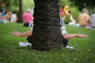 A Falun Gong practitioner meditating in Lumpini Park, Bangkok, Thailand