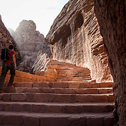 A visitor hikes up a hillside for a more unique view of the Treasury. The Nabatean city dates back to the second century B.C. Petra, Jordan, December 2013.