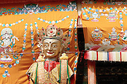 The articulated puppet of Buddha Maitreya, is shown to the crowd the last day of Monlam Chenmo (the Great Prayer) and carried to make a tour around the monastery of Labrang, in order to help the coming of a new cycle of time (kalpa). The Buddha Maitreya, also called the Buddha of the future is one of the most popular deities in Tibet because he symbolizes the hope of a better life after the reincarnation. Xiahe, China, March 5 2007.