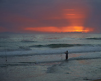 Surf Fishing at Dawn.  Playalinda Beach, Canaveral National Seashore in Florida. Image taken with a Nikon D700 camera and 28-3 00 mm VRlens (ISO 500, 85 mm, f/5.6, 1/320 sec).