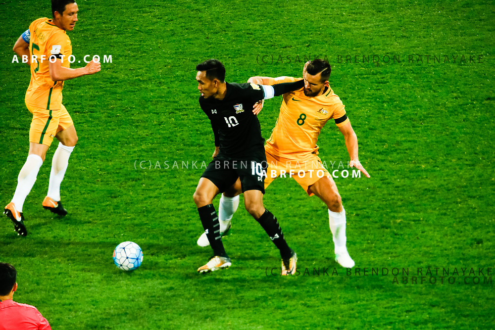 MELBOURNE, AUSTRALIA - SEPTEMBER 5 :  Teerasil Dangda of Thailand and Bailey Wright of the Australia Socceroos contest for the ball during the Stage 3 Group World Cup Football Qualifiers between Australia Vs Thailand at the Melbourne Rectangular Stadium, Melbourne, Australia 5 September 2017.